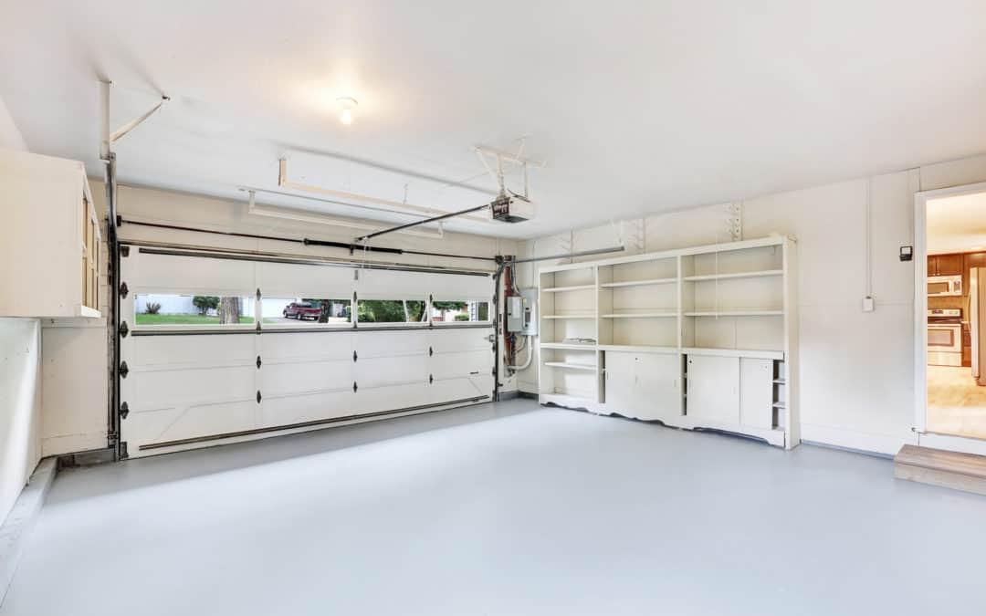 garage with an interior door and windows