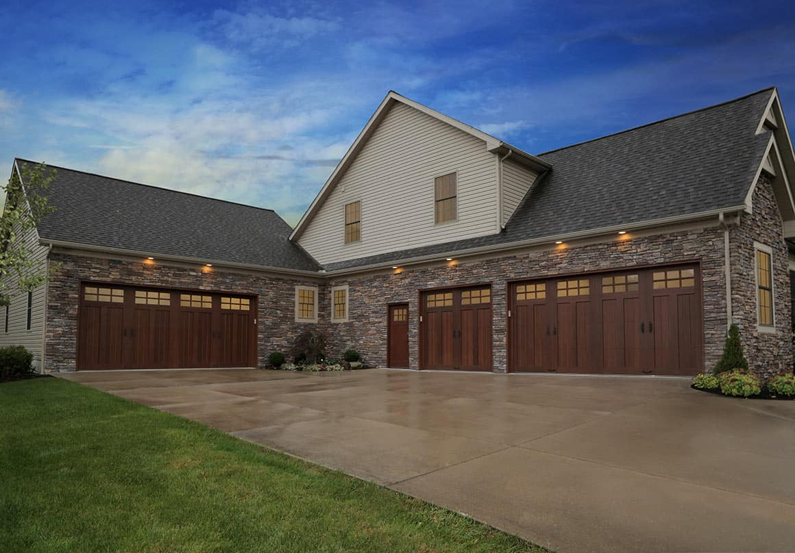 Multi-garage home with blue sky